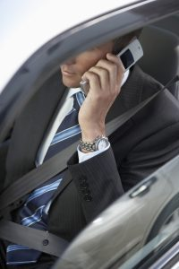 Professional Man in Car Using Cell Phone